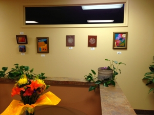 artwork on the wall at the women's center, with plants around