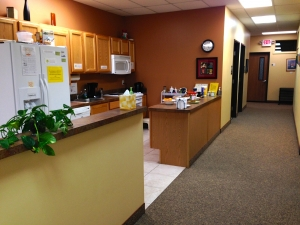 kitchen at the women's center, plant and snacks on the counter